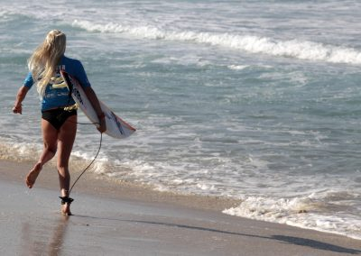 Enever runs before start of the women's Association of Surfing Professionals (ASP) Billabong Rio Pro championship on Barra da Tijuca beach in Rio de Janeiro -0OPM2349.jpg-